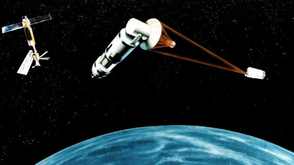 Concept art from 1984: Nuclear reactor-packed satellite fires lasers at a hostile space object. ©  Wikipedia / US Air Force