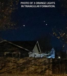 3 orange lights in triangular formation fly to the west